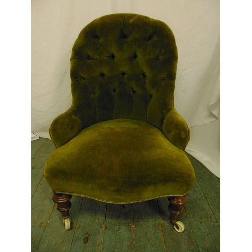 30 - A Victorian ladies button back upholstered chair on turned mahogany legs with original castors...
