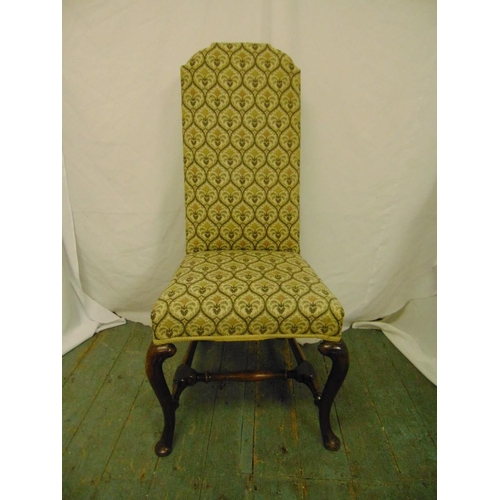 31 - A high back upholstered occasional chair on cabriole legs...
