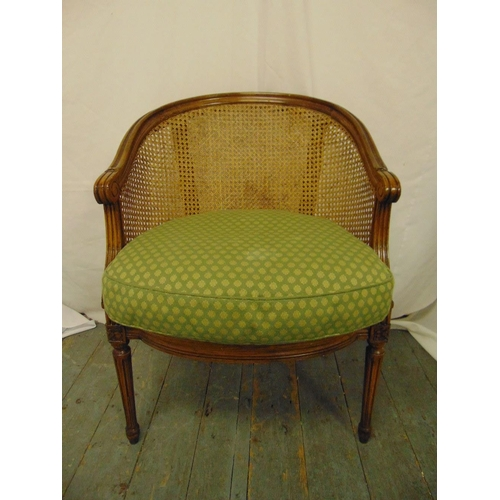 32 - A Victorian occasional chair with bergere cane and upholstered seat on fluted tapering cylindrical l...