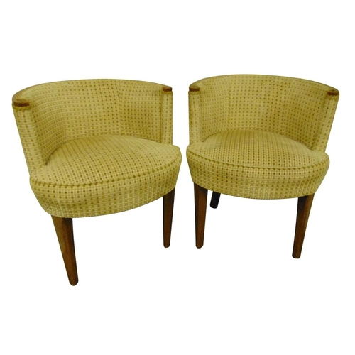 34 - A pair of Art Deco tub chairs with upholstered seats and backs on four tapering cylindrical legs...