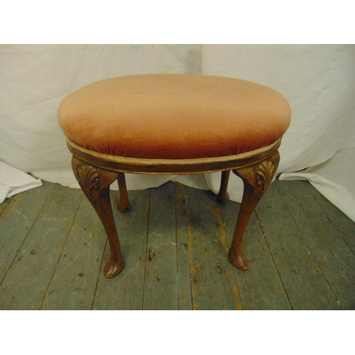 35 - A mahogany upholstered stool on four cabriole legs...
