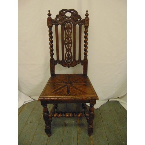 37 - A continental oak hall chair carved and pierced on turned legs...