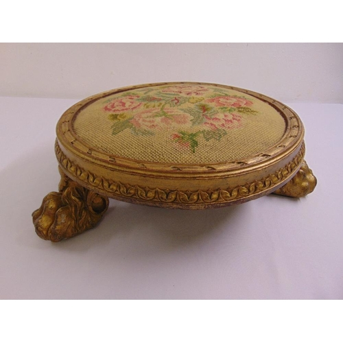 38 - A Regency circular gilded wooden embroidered foot stool...