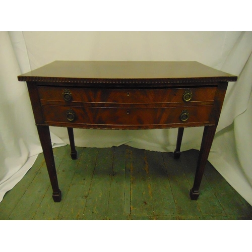4 - A rectangular mahogany two drawer table with brass handles on tapering rectangular legs...