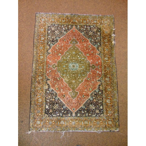 40 - A Persian silk carpet central rosette stylised leaves and vegetation predominantly browns, blues and...