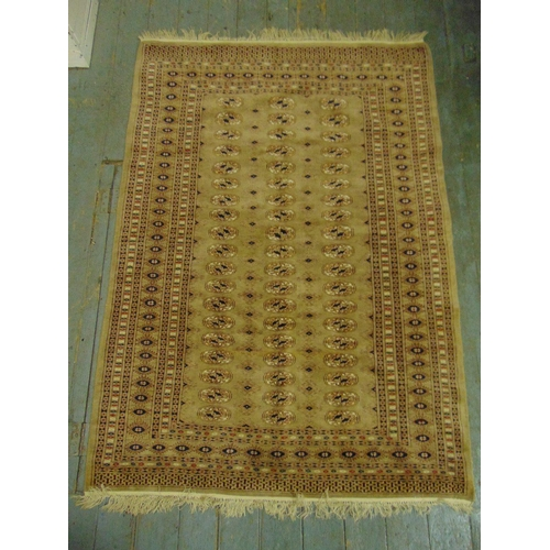 41 - A Persian wool carpet tan ground with geometric repeating pattern and border, 175 x 129.5cm...