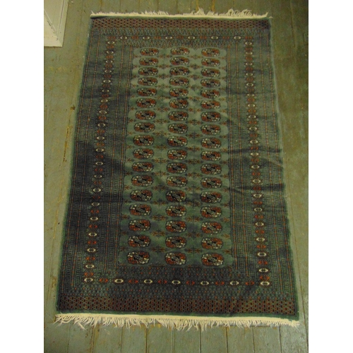 42 - A Persian wool carpet blue ground with geometric repeating pattern and border, 175 x 130cm...
