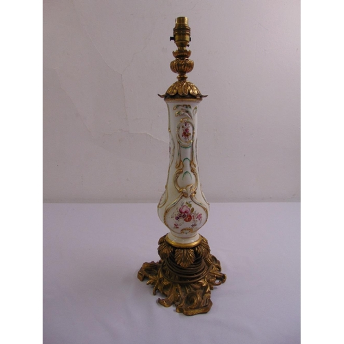 46 - A 19th century continental porcelain lamp base with ormolu mounts converted to electricity...