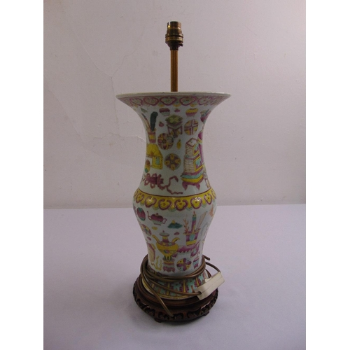 50 - An early Chinese porcelain table lamp decorated with stylised leaves and furniture on carved hardwoo...