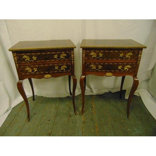6 - A pair of inlaid Kingswood rectangular side tables each with two drawers on four cabriole legs...