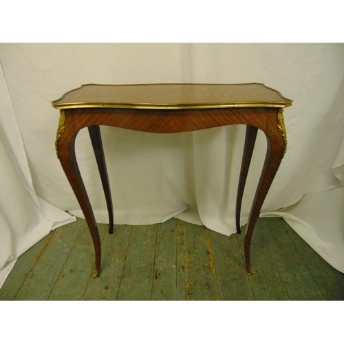8 - A rectangular Kingswood hall table with applied brass mounts on four cabriole legs...