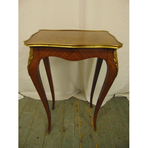 9 - A rectangular Kingswood side table with applied gilded metal mounts on four cabriole legs...