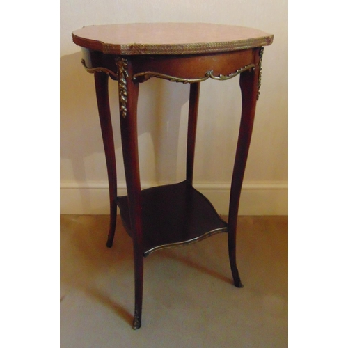 17 - A mahogany side table of shaped rectangular form with marble top and cabriole legs...