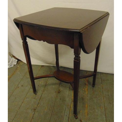 20 - An Edwardian mahogany rectangular drop flap tea table on tapering legs...