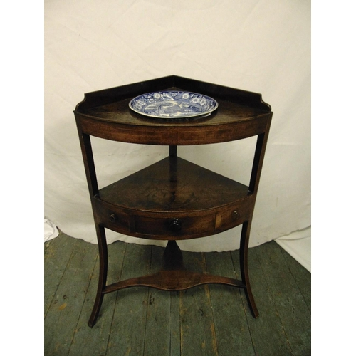 21 - A Victorian mahogany corner unit with single drawers on three outswept legs...