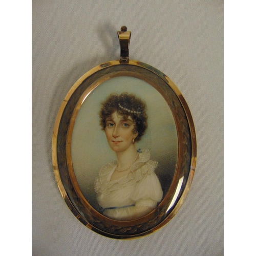 219 - William Thicke framed and glazed miniature of a lady wearing pearls in her hair, the oval copper fra...