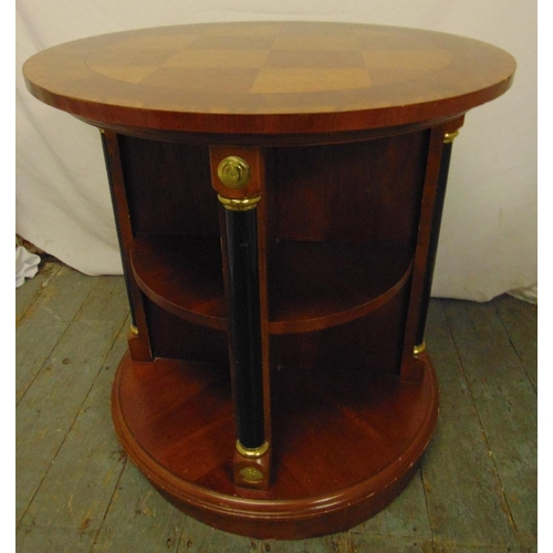 22 - A mahogany cylindrical inlaid revolving bookcase with gilt metal mounts...