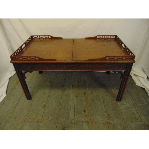23 - A Chinese style rectangular coffee table with pierced gallery and leather top opening to reveal a gl...
