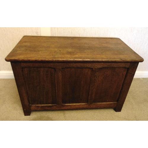 24 - An oak rectangular blanket box with hinged cover, on bracket feet...