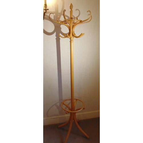 27 - A Bentwood hat and coat stand of customary form...