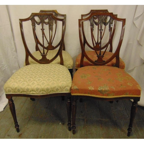 30 - Four Edwardian mahogany dining chairs with pierced shield backs, on tapering cylindrical legs...