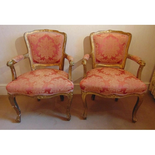 31 - A pair of French style upholstered bedroom armchairs on cabriole legs...