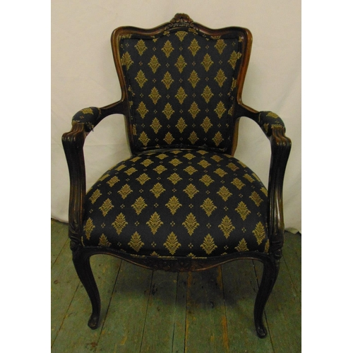 32 - A French style upholstered mahogany armchair on cabriole legs...
