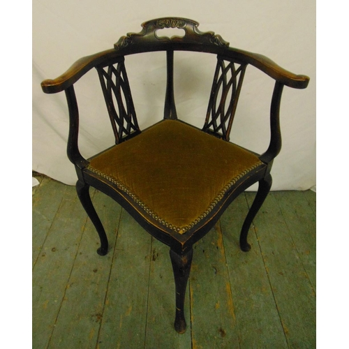 38 - An Edwardian mahogany corner chair with pierced slats, upholstered seat on cabriole legs...