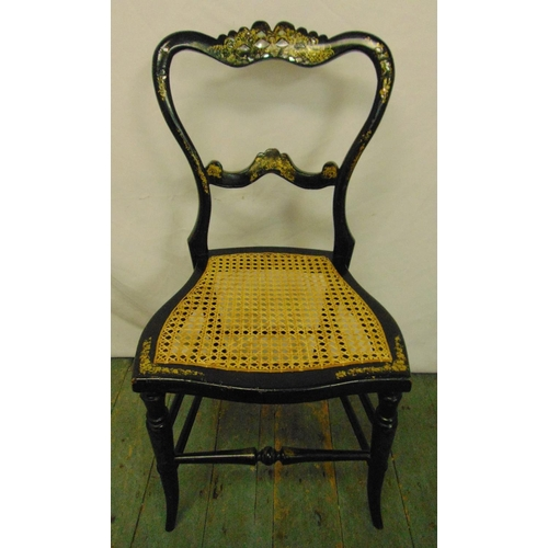 39 - A 19th century lacquered mother of pearl inlaid boudoir chair with hand caned seat and ebonised fram...