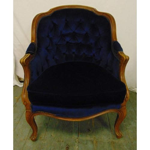 40 - An early 20th century mahogany upholstered continental occasional chair on cabriole legs...