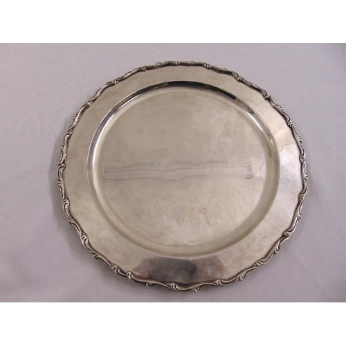 405 - A Mexican white metal charger with scroll borders...