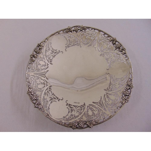 411 - A silver circular fruit stand with scroll pierced sides and applied vine border on circular rimmed f...