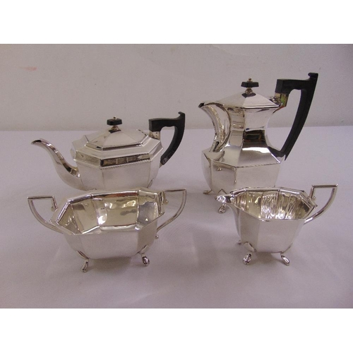 413 - A silver four piece tea and coffee set of elongated octagonal form on four claw feet to include coff...