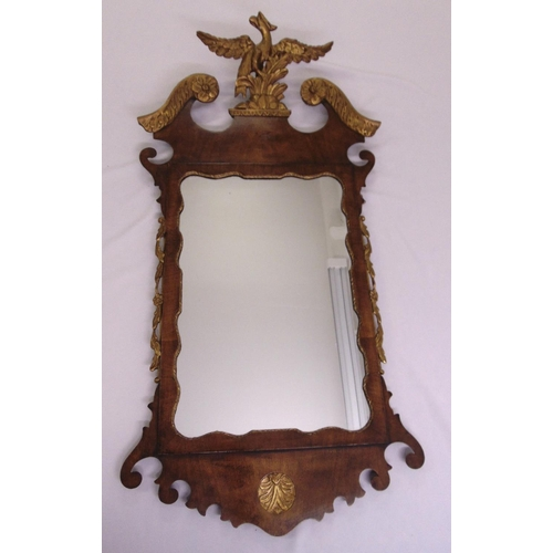 44 - A late 19th century continental mahogany rectangular framed wall mirror with gilded decoration...