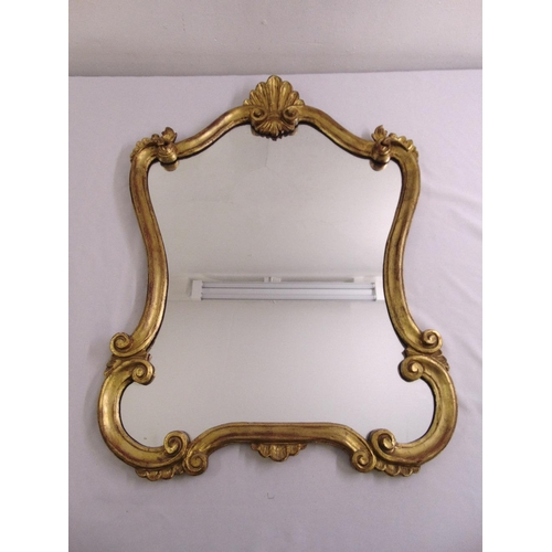 45 - An Art Nouveau style gilded wooden wall mirror...