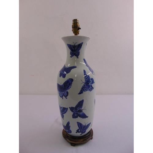 47 - A Chinese blue and white baluster vase converted to a table lamp decorated with butterflies, mounted...