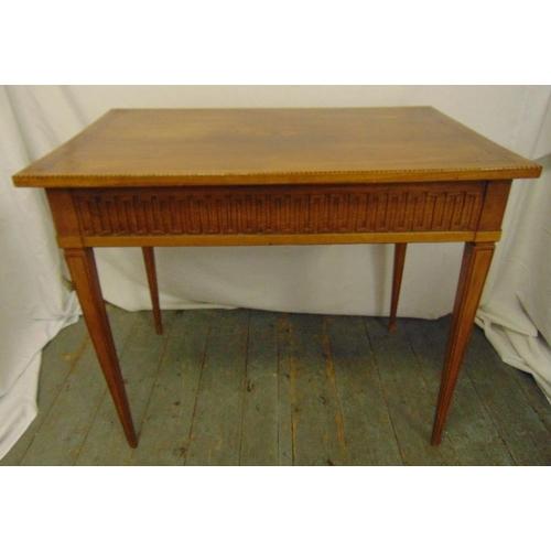 7 - An Edwardian mahogany rectangular desk on four tapering rectangular legs...