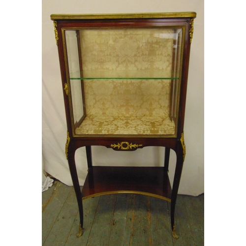 9 - A French style rectangular glazed display case with gilt metal mounts, on cabriole legs, retailed by...