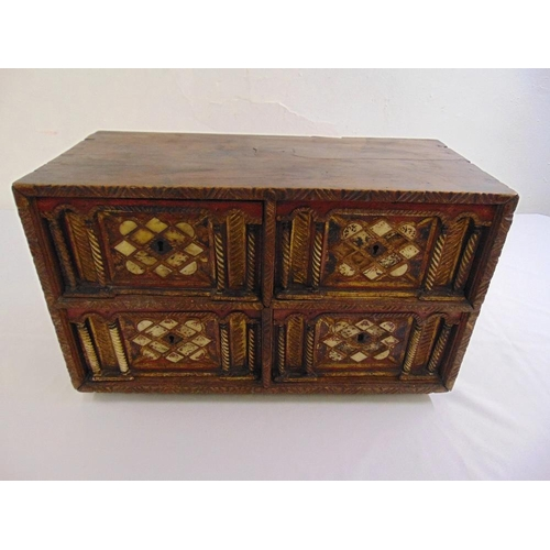 11 - Indo-Portuguese rectangular cabinet, the four drawers carved with free standing columns and inset wi...