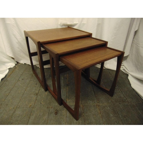 16 - A G-Plan teak nest of three rectangular tables...