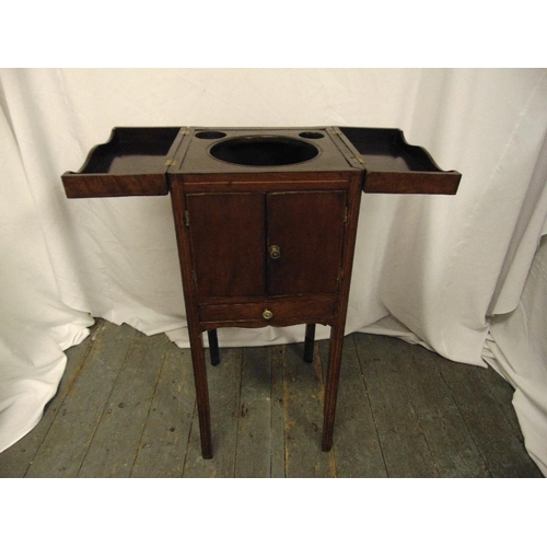 19 - An early 20th century rectangular mahogany wash cabinet with hinged top and cupboard doors on four t...