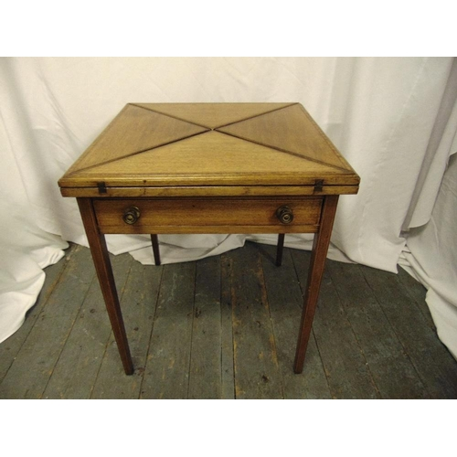 2 - An Edwardian oak square envelope card table with single drawer on four tapering rectangular legs...