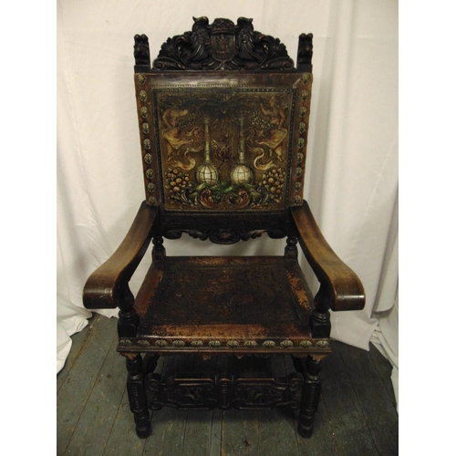 20 - An antique Spanish walnut throne, heavily carved and with embossed coloured seat and back, possibly ...