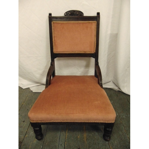 25 - An Edwardian mahogany upholstered nursing chair on turned cylindrical legs...