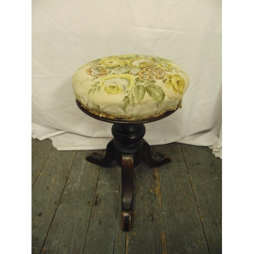 30 - A Victorian circular piano stool on three outswept legs...