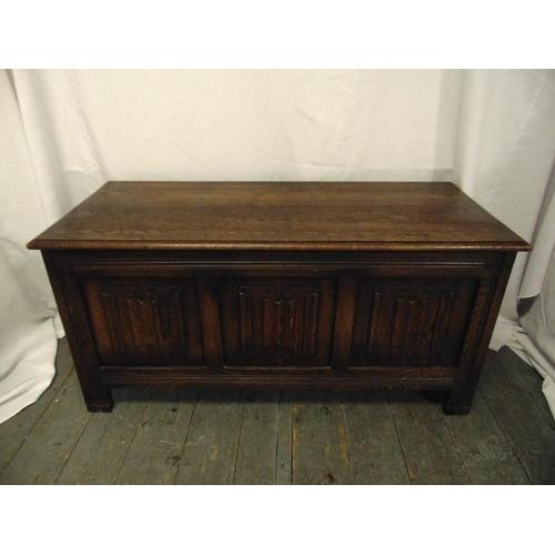 33 - A rectangular oak blanket box with hinged cover on bracket feet...