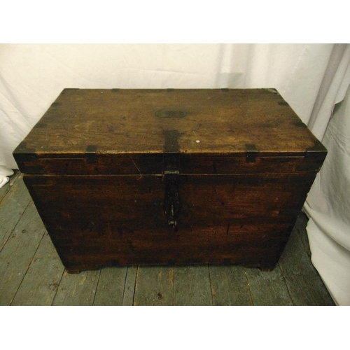 36 - A 19th century rectangular brass bound mahogany campaign chest with hinged cover...