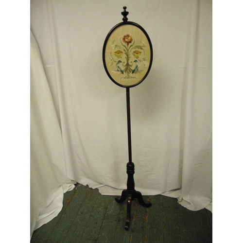 39 - A Victorian mahogany screen pole the oval glazed panel decorated with birds and flowers...