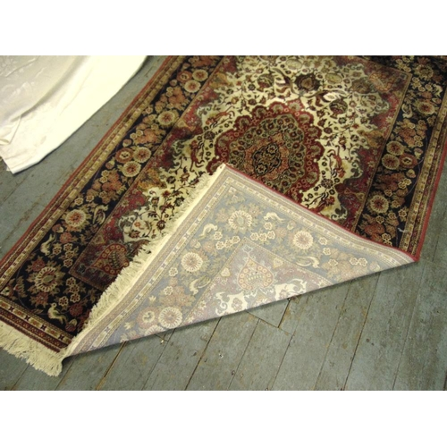 40 - A Persian silk and wool carpet, red and green ground with birds flowers and repeating patterns withi...