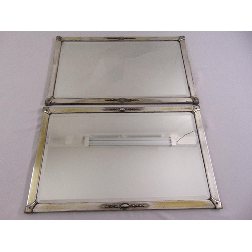 43 - A pair of rectangular silver plated framed wall mirrors, 40.5 x 66cm...